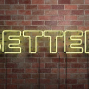 better-in-neon-lights-against-brick-wall